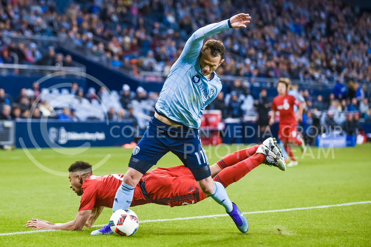 Sporting KC midfielder Brad Davis, formerly of the rival Houston Dynamo, steals the ball away from Toronto FC defender Justin Morrow with a controversial possible foul on the edge of the 18-yard box en route to scoring his first goal with Sporting KC in the second half of Sporting's 1-0 victory over Toronto Mar. 20, 2016, at Children's Mercy Park in Kansas City, Kansas. (Parker Robb   The Collegian)