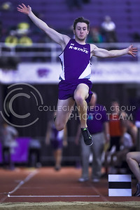 Long jumper Tom Pyle, freshman in physics, takes off from the line and soars as far as he can over the sand at the DeLoss Dodds Invitational track & field meet Jan. 23, 2016, in Ahearn Fieldhouse. (Parker Robb | The Collegian)