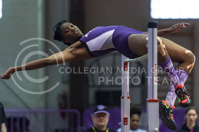 Senior pentathlete Akela Jones jumps toward a height of 1.85m in the pentathlon high jump on her way to breaking the K-State and Ahearn Fieldhouse pentathlon records with a total score of 4,643 points at the DeLoss Dodds Invitational track and field meet Jan. 22, 2016, in Ahearn Fieldhouse. (Parker Robb | The Collegian)