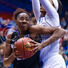 Junior forward Brianna Lewis spins around Kasnas forward Caelynn Manning-Allen to reach the basket in the third quarter of the the Wildcats' ugly 59-46 victory over the Jayhawks in the first leg of the annual Sunflower Showdown Jan. 20, 2016, in Allen Fieldhouse in Lawrence, Kansas. (Parker Robb   The Collegian)