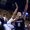Junior forward Erica Young takes a shot over Kansas forward Jada Brown in the first quarter of the the Wildcats' ugly 59-46 victory over the Jayhawks in the first leg of the annual Sunflower Showdown Jan. 20, 2016, in Allen Fieldhouse in Lawrence, Kansas. (Parker Robb   The Collegian)