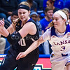 Sophomore forward Shaelyn Martin attempts to dribble past Kansas guard Lauren Aldridge in the first quarter of the the Wildcats' ugly 59-46 victory over the Jayhawks in the first leg of the annual Sunflower Showdown Jan. 20, 2016, in Allen Fieldhouse in Lawrence, Kansas. (Parker Robb   The Collegian)