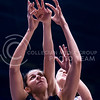 Junior forward Jessica Sheble and Kansas guard Kylee Kopatich reach for a rebound in the second quater of the the Wildcats' ugly 59-46 victory over the Jayhawks in the first leg of the annual Sunflower Showdown Jan. 20, 2016, in Allen Fieldhouse in Lawrence, Kansas. (Parker Robb   The Collegian)