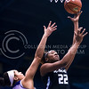 Junior forward Brianna Lewis sneaks past Kansas forward Tyler Johnson for a layup in the third quarter of the the Wildcats' ugly 59-46 victory over the Jayhawks in the first leg of the annual Sunflower Showdown Jan. 20, 2016, in Allen Fieldhouse in Lawrence, Kansas. (Parker Robb   The Collegian)