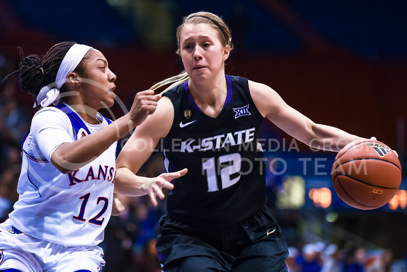 Redshirt junior guard Kelly Thomson dribbles up the lane past Kansas guard Timeka O'Neal in the fourth quarter of the Wildcats' ugly 59-46 victory over the Jayhawks in the first leg of the annual Sunflower Showdown Jan. 20, 2016, in Allen Fieldhouse in Lawrence, Kansas. (Parker Robb | The Collegian)