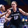 Redshirt junior guard Kelly Thomson dribbles up the lane past Kansas guard Timeka O'Neal in the fourth quarter of the Wildcats' ugly 59-46 victory over the Jayhawks in the first leg of the annual Sunflower Showdown Jan. 20, 2016, in Allen Fieldhouse in Lawrence, Kansas. (Parker Robb   The Collegian)
