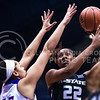 Junior forward Brianna Lewis attempts to put a jump shot past Kansas forward Tyler Johnson in the third quarter of the the Wildcats' ugly 59-46 victory over the Jayhawks in the first leg of the annual Sunflower Showdown Jan. 20, 2016, in Allen Fieldhouse in Lawrence, Kansas. (Parker Robb   The Collegian)