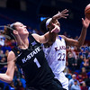 Junior forward Breanna Lewis reaches for a rebound over Kansas guard Kylee Kopatich in the fourth quarter of the Wildcats' ugly 59-46 victory over the Jayhawks January 20, 2016, in Allen Fieldhouse in Lawrence, Kansas. Lewis led the 'Cats with 23 points and 13 rebounds, and set the K-State record for career games with seven or more blocks with her seven blocks on the night. (Parker Robb   The Collegian)