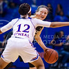 Junior guard Kindred Wesemann points instructions to teammates as she is held at an impasse by Kansas guard Timeka O'Neal in the fourth quarter of the the Wildcats' ugly 59-46 victory over the Jayhawks in the first leg of the annual Sunflower Showdown Jan. 20, 2016, in Allen Fieldhouse in Lawrence, Kansas. (Parker Robb   The Collegian)