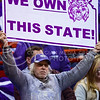 K-State superfan Robert Lipson, who travels to virtually every road football and basketball game, flashes a sign claiming the State of Kansas for K-State in KU's Allen Fieldhouse in Lawrence, Kansas, during the womens' basketball game against the Jayhawks Jan. 20, 2016. (Parker Robb | The Collegian)