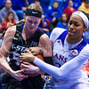 Sophomore forward Shaelyn Martin struggles with Kansas forward Caelynn Manning-Allen for possession of the ball in the second quarter of the the Wildcats' ugly 59-46 victory over the Jayhawks in the first leg of the annual Sunflower Showdown Jan. 20, 2016, in Allen Fieldhouse in Lawrence, Kansas. (Parker Robb | The Collegian)