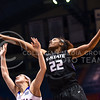 Junior forward Breanna Lewis reaches for a rebound over Kansas guard Kylee Kopatich in the fourth quarter of the Wildcats' ugly 59-46 victory over the Jayhawks January 20, 2016, in Allen Fieldhouse in Lawrence, Kansas. Lewis led the 'Cats with 23 points and 13 rebounds, and set the K-State record for career games with seven or more blocks with her seven blocks on the night. (Parker Robb | The Collegian)
