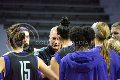 Head coach Jeff Mittie talks with the women's basketball players before the start of the scrimmage in Bramlage Coliseum on Oct. 17, 2015. (Cassandra Nguyen | The Collegian)