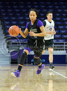 K-State senior guard Antoinette Taylor dribbles the ball during the women's basketball scrimmage on Oct. 17, 2015 in Bramlage Coliseum. (Cassandra Nguyen | The Collegian)