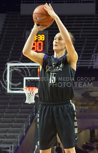 K-State senior guard Megan Deines attempts to score a point during the women's basketball scrimmage on Oct. 17, 2015 in Bramlage Coliseum. (Cassandra Nguyen | The Collegian)
