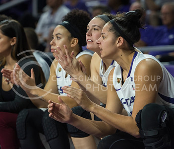 Junior forward Jessica Sheble, sophomore forward Kaylee Page and senior guard Bri Craig cheer for their teammates in the game against Pitt State on Nov. 9, 2015 at Bramlage Coliseum.  The Wildcats barely pulled out a win against Pitt State with a score 58-50.  (Rodney Dimick | The Collegian)