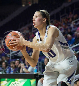 Freshman guard Kayla Goth prepares to shoot from the sideline on Nov. 9, 2015 at Bramlage Coliseum.  The Wildcats won against the Gorillas 58-50.  (Rodney Dimick | The Collegian)