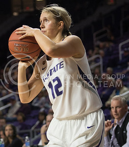 Junior guard Kelly Thomson prepares to pop a shot in the game against Washburn on Nov. 2, 2015 at Bramlage Coliseum.  The Cats cranked up the heat in the last half of the game and won 75-48.  (Rodney Dimick | The Collegian)