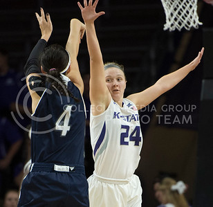Junior guard Kindred Wesemann throws out her arms to block a shot on Nov. 2, 2015 at Bramlage Coliseum.  K-State beat WU 75-48.  (Rodney Dimick | The Collegian)