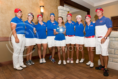 Southern Methodist University players pose in the clubhouse of Colbert Hills after winning the Marilynn Smith/Sunflower Inviational on Sep. 8, 2015. (Evert Nelson | The Collegian)