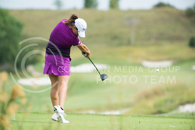 Madison Talley, junior, powers through her stroke off hole 8 Colbert Hills on Sep. 8, 2015 during the Marilynn Smith/Sunflower Invitational. (Evert Nelson | The Collegian)