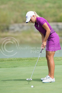 Paige Nelson, junior, watches her ball drop in the hole of number 9 at Colber Hills during the Marilynn Smith/Sunflower Invitational on Sep. 8, 2015. (Evert Nelson | The Collegian)
