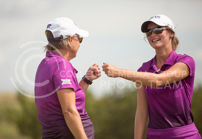 Kristi Knight, head coach of women's golf, and junior Katherine Gravel-Coursol fist bump during the Marilynn Smith/Sunflower Invitatoinal at Colbert Hills Golf Course on Sep. 8, 2015. (Emily Starkey | The Collegian)