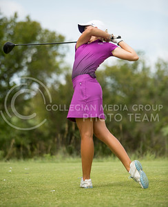 Paige Nelson, junior, follows through her swing during the Marilynn Smith/Sunflower Invitatoinal at Colbert Hills Golf Course on Sep. 8, 2015. (Emily Starkey | The Collegian)