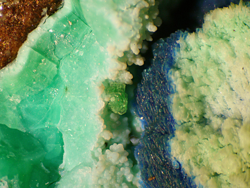 Small cluster of green meta-torbernite crystals from Black Copper Wash near Kelvin, with various copper minerals