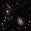 NGC  4725 single arm spiral galaxy with neighboring galaxies