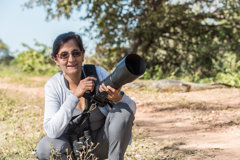 Chand, our great friend and travel buddy...the long lens can help fend off the caiman!