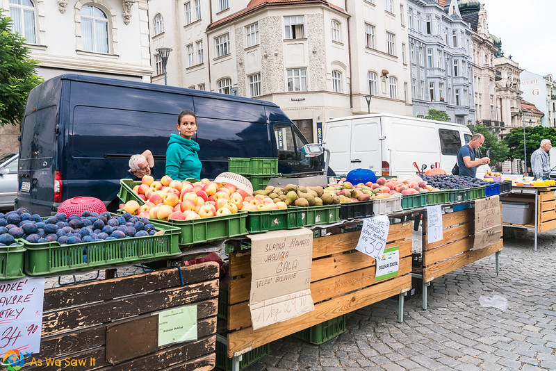 Woman at vegetable stand in Zelny Trh, Brno