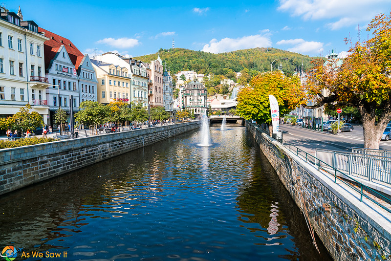 Brick lined river with fountain in Karlovy Vary