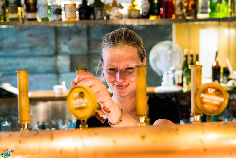 Waitress pouring beer in a Kromeriz brew house