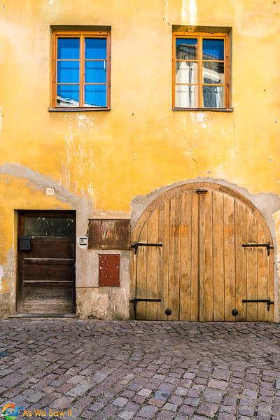 Yellow walls contrast with blue sky in LItomysl, Czechia