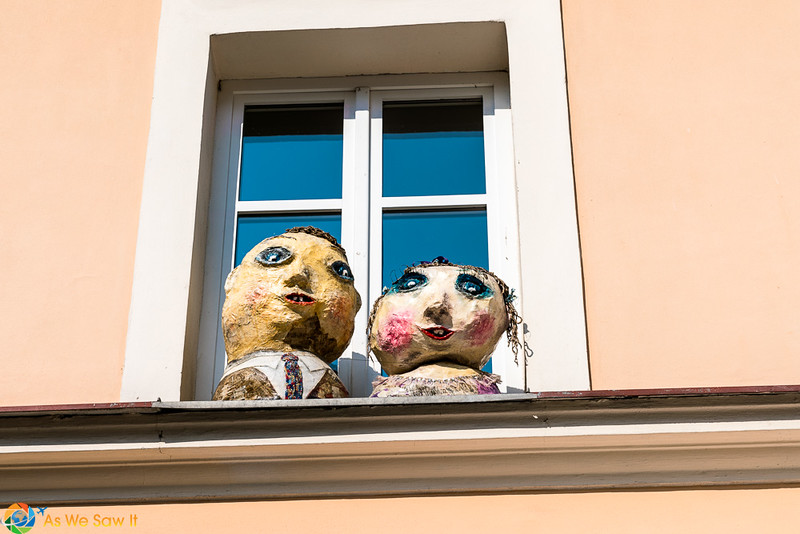 Handmade busts of a man and woman on a window ledge