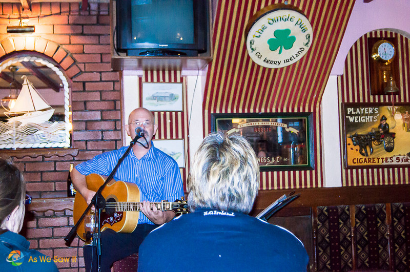 Trad music in Dingle pub: Man playing guitar