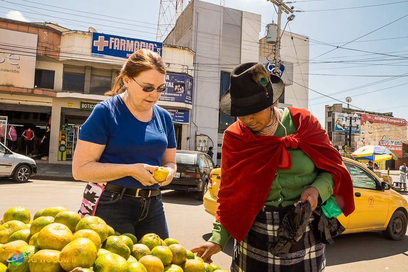 Linda examines an orange that a vendor tried to overcharge her for.