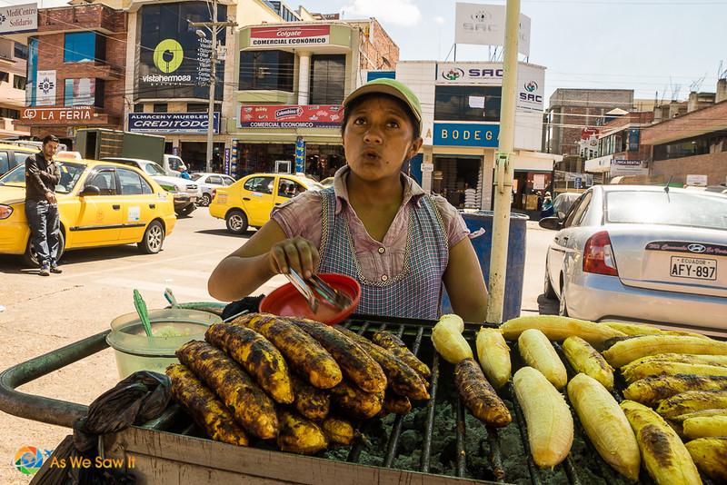 Feria Libre vendor woman grilling bananas, a popular Cuenca street food