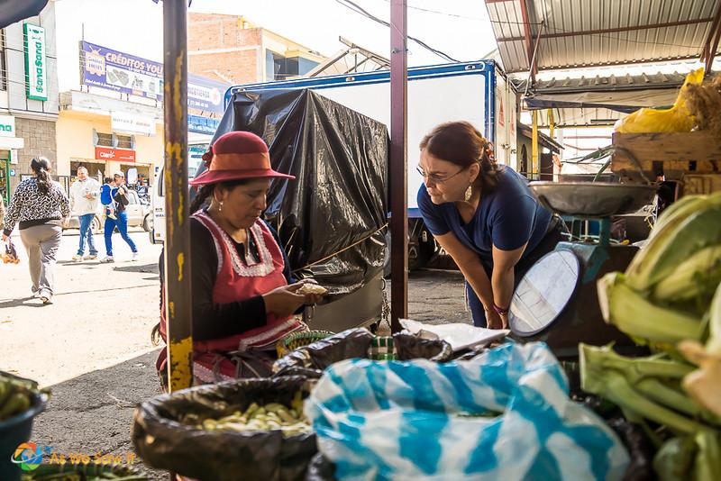 Linda talks to a vendor at the market