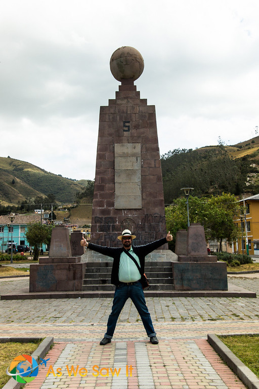 Dan poses on the Equator line in Calacalí, Ecuador