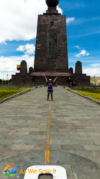 Linda poses on the other side of the Equator monument at Mitad del Mundo