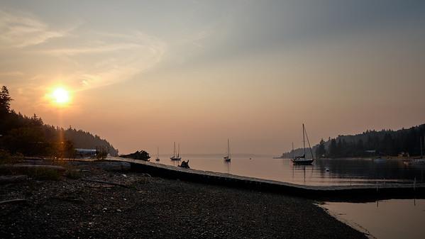 Smoky sunrise at Blakely Harbor