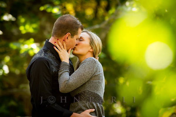 Chicago engagement photography wedding pictures couple kissing in park Rockford photographer