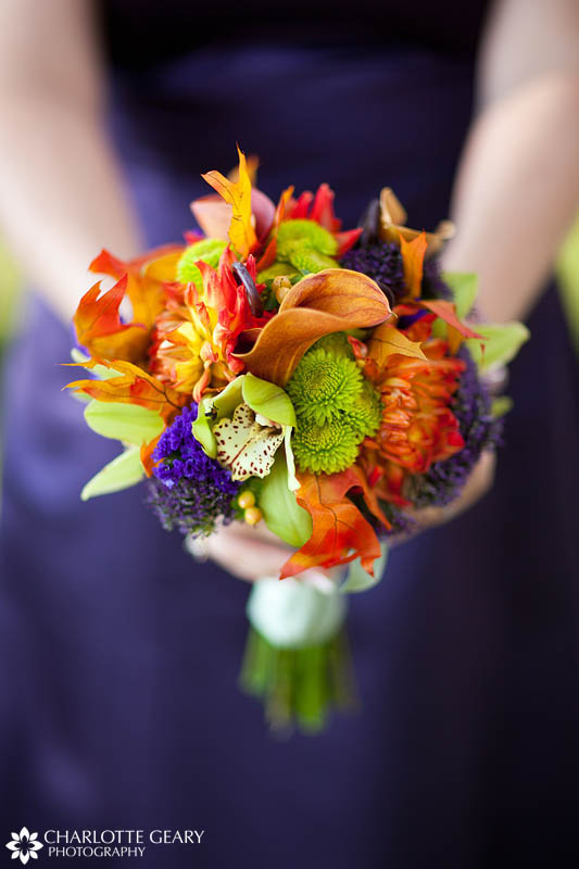 Bridesmaid with purple dress and orange flowers