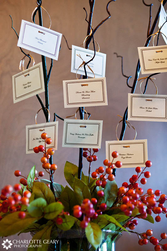 Place cards hung from tree