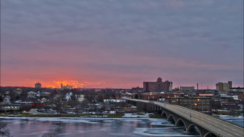 Braved the bone chilling cold to catch a quick glimpse of the sunrise over downtown Rockford on New Year's Day 2011...glad I did. Took a very brief time-lapse of the sunrise before it disappeared behind the clouds, and the wind drove me back indoors.  Music track is from