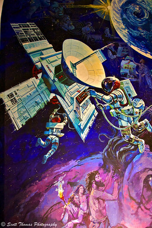 A mural outside the entrance to Spaceship Earth depicting Mankind's advancements in communications.