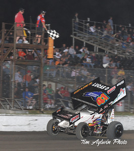 Jason Johnson takes the checkered flag in Friday night's Lucas Oil ASCS presented by K&N Filters main event at the 38th Annual Devil's Bowl Spring Nationals. (Tim Aylwin photo)