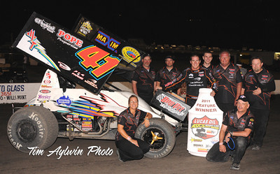 Jason Johnson and crew in Lucas Oil ASCS presented by K&N Filters victory lane after topping Friday night's 38th Annual Devil's Bowl Spring Nationals 25-lap preliminary feature in Mesquite, TX. (Tim Aylwin photo)